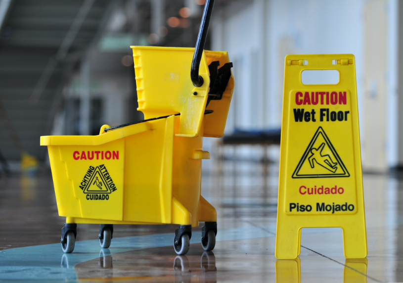 Commercial mop bucket with wringer and OSHA caution wet floor sign